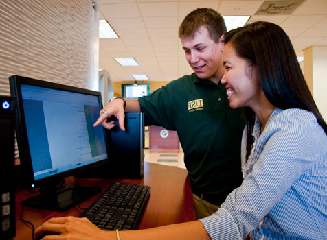 A career services worker assists a smiling student