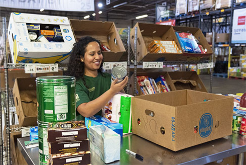 A woman working at a food pantry